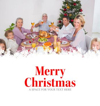 Family raising their glasses at christmas against merry christmas