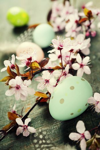 Easter composition with painted eggs and Cherry Blossom branches