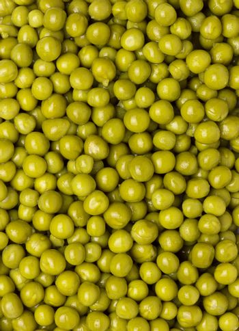 background of wet green peas