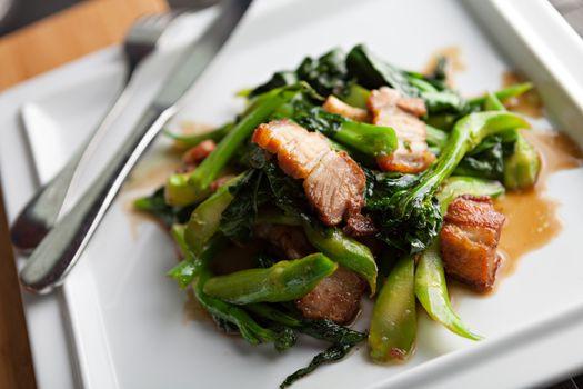 Thai style crispy pork dish with Chinese broccoli.