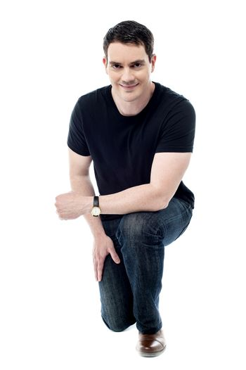 Casual man posing crouched