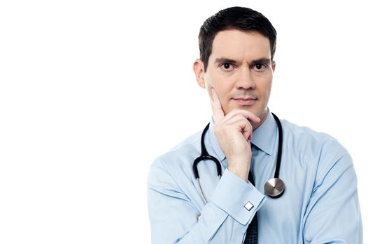 Pensive physician looking at camera