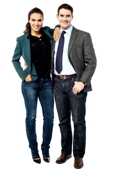 Full length of business couple posing