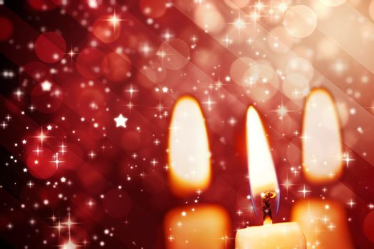 Twinkling stars against candle