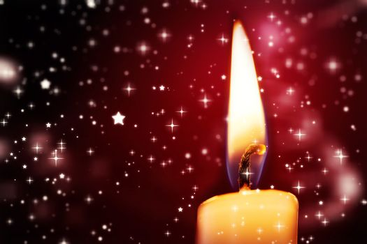 Twinkling stars against candle burning