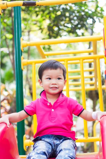 Asian boy relax in the park, stock photo