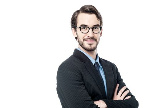 Handsome businessman with folded arms