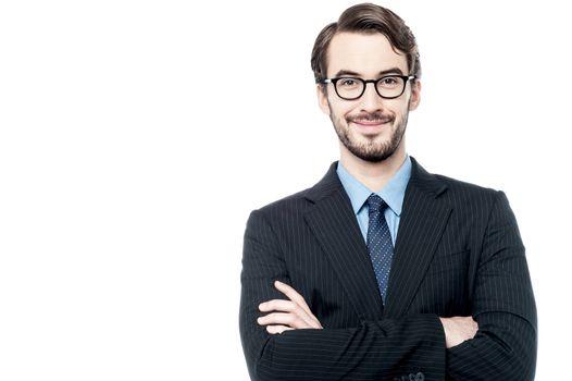 Confident entrepreneur posing over white
