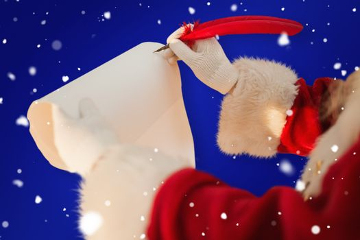 Composite image of santas hand writing list with a quill