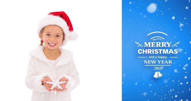 Festive little girl holding snowflake against blue vignette