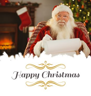 Composite image of happy santa writing list with a quill