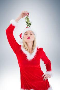 Festive blonde holding some mistletoe