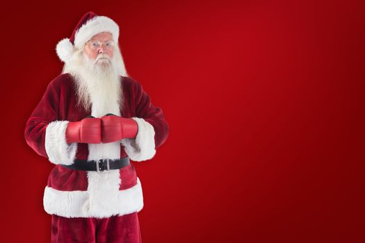 Composite image of santa claus wears boxing gloves
