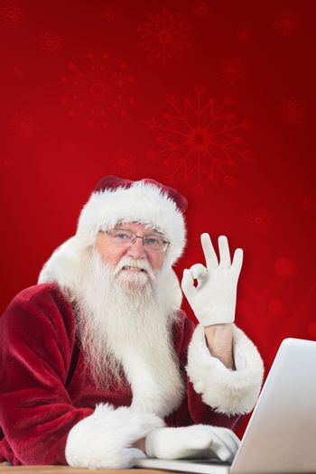 Composite image of santa is satisfied about what he found