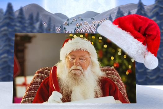 Composite image of santa claus writing his list with a quill