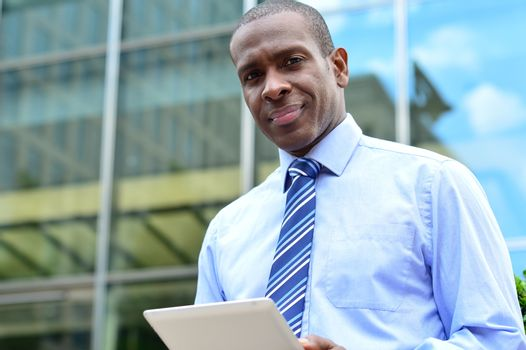 Corporate executive using a tablet pc