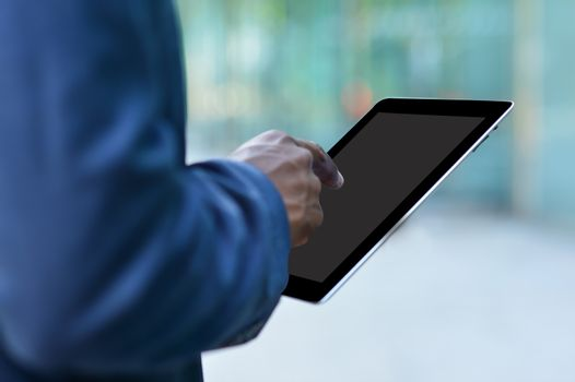Corporate man working with a digital tablet