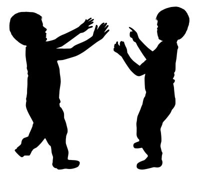 Silhouettes of two young boys showing something with finger