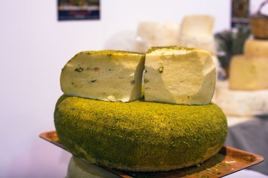 Sicilian cheese dressed with pistachio nuts grind