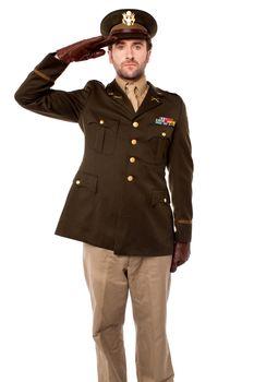 Army officer saluting, studio shot