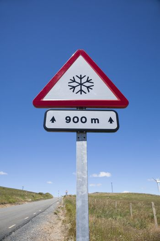 snow dangerous road signal