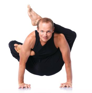 Yoga man. Young and handsome man doing yoga. Isolated on white backgraund