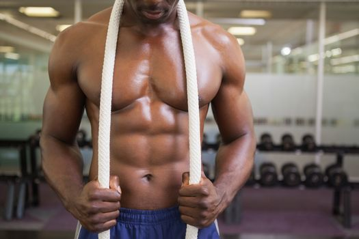 Muscular young muscular man in gym