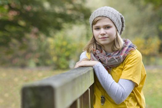 young girl in the autumn park - portrait