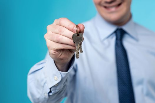 Realtor giving the keys to home