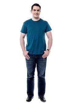 Full length of casual man posing
