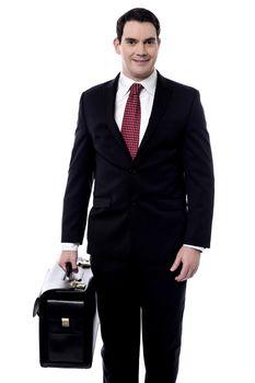 Male entrepreneur carrying a briefcase