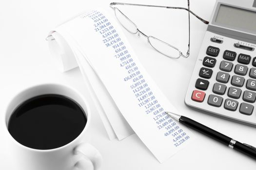 accounting concept with summary purchasing paper rolls on office table in white tone