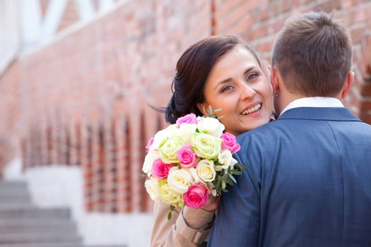 bride with bouquet and groom