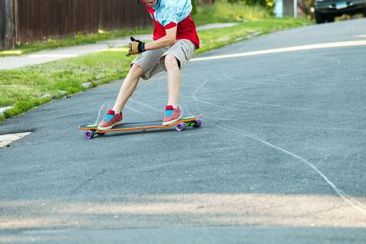 Action shot of a longboarder skating on an urban road.