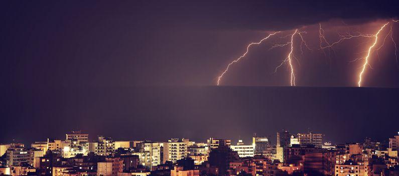 Lightning over night city
