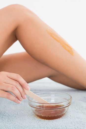 Female leg with hot wax at spa center