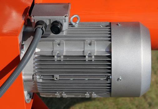 Red powerful electric motors for modern industrial equipment
