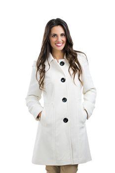 Beautiful woman posing using a winter coat