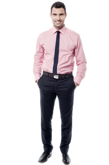 Relaxed middle aged businessman posing