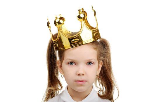 A little girl wears a crown