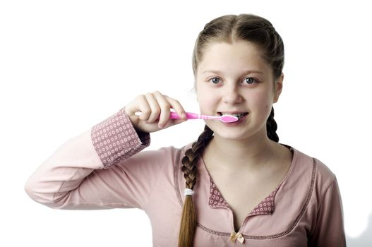 Cute girl brushing teeth isolated on white