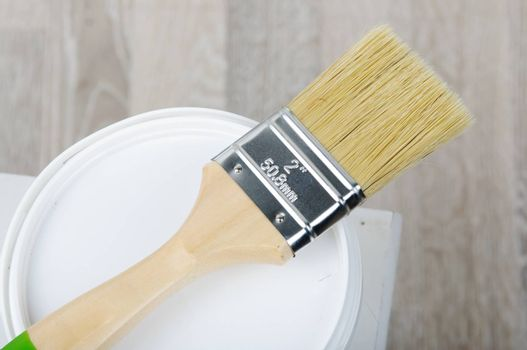 Repair. An image of paintbrush with bucket.