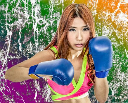 Chinese woman boxer with grunge texture in pink top wearing boxing gloves