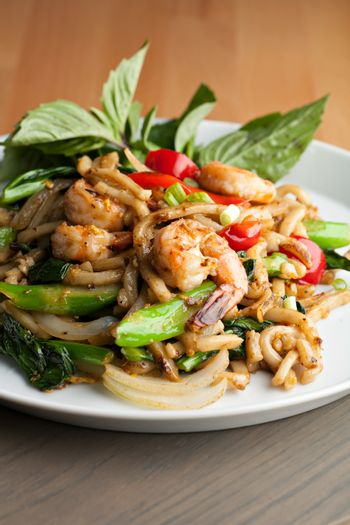Thai food shrimp stir fry with lo mein noodles Shallow depth of field.