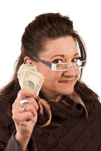 Brunette woman holding up some money in her hand.