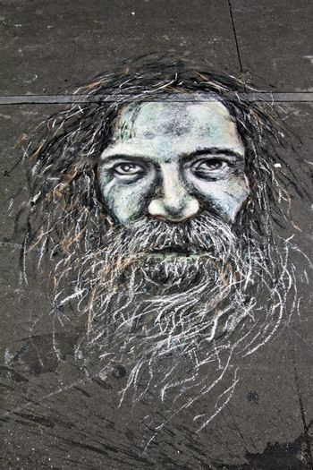 Street art made with color chalk on the shoulder