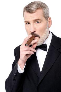 Boss smoking a cigar