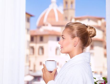 Drinking coffee on the balcony