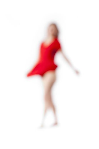 Abstract Out of Focus Image of a Woman in Red Dress