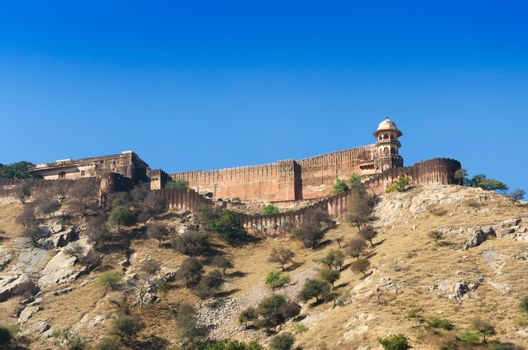Ancient walls of Amber Fort with landscape in Jaipur